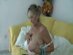 Granny with big tits masturbates in p...
