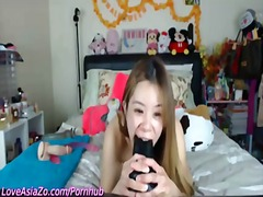 Asia zo fuckes herself with lots of toys live for her fans