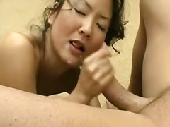 Asian bitch jerking off ramrod for cum on her face