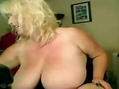 Busty granny in webcam video