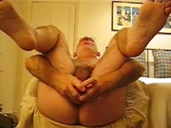 Mature stud toying his...