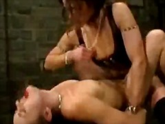 Girl spanked sucking and fucked with strapon by mistress in the dungeon