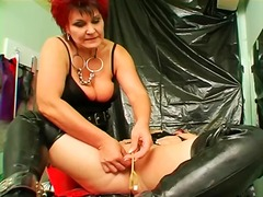 Mistress inserts catheter into sub girl