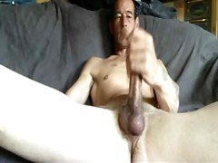 Guy jerking his big cock