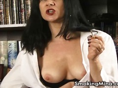 See: Sexy brunette smoking ...