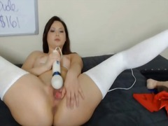 Cute girl rubs her vibrator on her clit