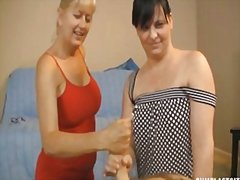 Two milfs jerking naked guy - 04:05