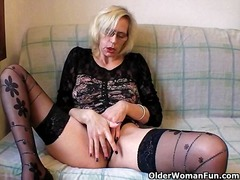 Slutty grandma in stockings fists her hairy cunt