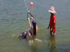 Three playmates try out wake boarding