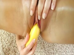 Sexy hot brunette babe peaches oils up as she takes on a huge cucumber in a hot solo action
