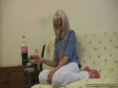 Blonde wig on cute girl pouring drinks