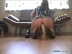 Ashley riding 2 big toys at home