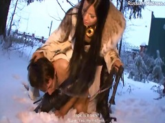 Mistress abuses a guy in the snow