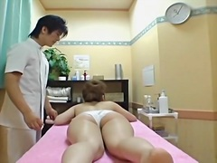 Oiled up Jap gets fingered in hidden cam massage fun