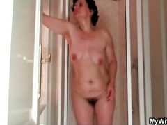 Mature showers her curvy body and hairy pussy