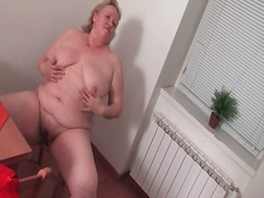 Horny fat housewife naked in her kitchen