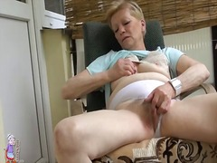 Granny masturbates on deck in panties