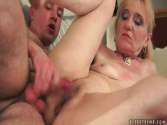 Sexy mature on her bac...