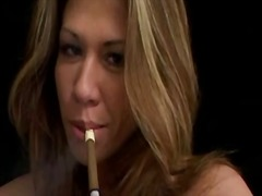 Pierced nips girl smokes and toys her pussy