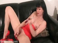 Smoking girl masturbates her shaved pussy