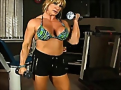 Mature female bodybuilder works out n...