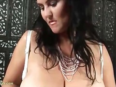 Thumb: Mature pulls out her h...