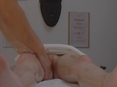 Extremely passionate redhead seduced in massage room