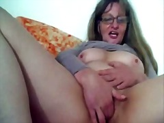 Horny granny playing with cucumber on...