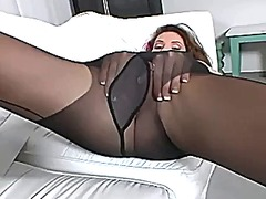 Brunette with big tits rubbing her pussy in nylon
