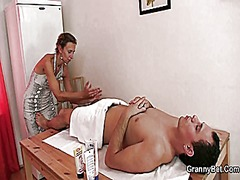 Mature masseuse takes it from behind