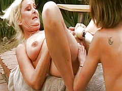 Mature lesbian teacher fucks her sexiest student's young pussy