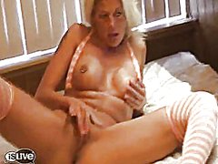 Milf in stockings fucks her twat with a dildo
