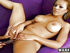 Two charming ebony lesbians share a glass dildo and experience outstanding pleasure