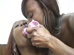 Lusty ebony lesbian loves fucking her girlfriend's cunt with a strap-on