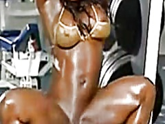 Dark female muscles at roomsport- large clito.