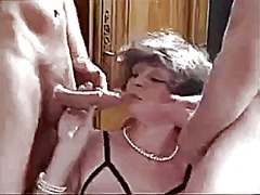 German mature fucks two cocks