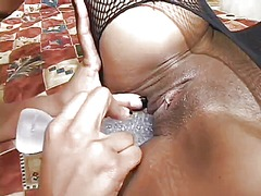 Naughty ebony lesbian bitches ride on their double ended dildo
