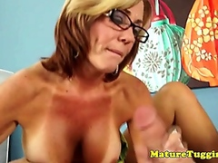 Busty mama cougar spoiling cock with tugjob session