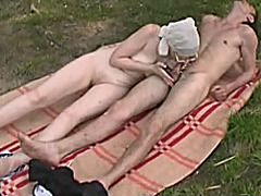 Russian mature mom and her boy on the...
