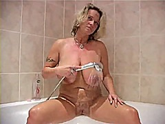 Mature woman taking sh...