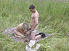 Mature mom and her boy on nature! rus...