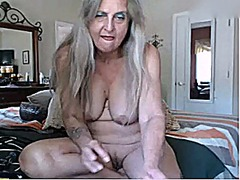 Thumbmail - Nice granny playing wi...
