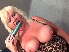 Busty old woman shows her massive tit...