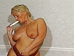 Thumb: Mature milf strips and...