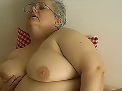 Old chubby granny with big tits plays...