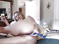 hot busty mature babe inserts anal pl...