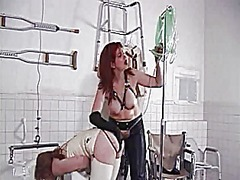 Xhamster Movie:Red head in white leather gets...