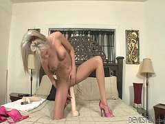Gorgeous blonde fucks herself with a huge dildo