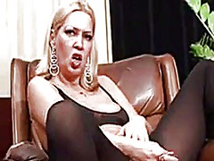 Mature blonde masturbates and smokes