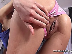 Brunette enjoys pissing